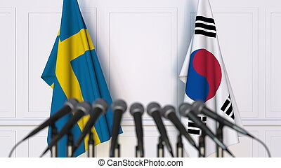 Flags of Sweden and Korea at international meeting or conference. 3D rendering
