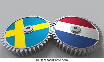 Flags of Sweden and Netherlands on meshing gears. International cooperation conceptual 3D rendering