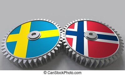 Flags of Sweden and Norway on meshing gears. International...