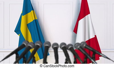 Flags of Sweden and Peru at international meeting or...
