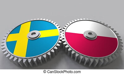 Flags of Sweden and Poland on meshing gears. International...