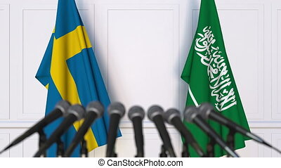 Flags of Sweden and Saudi Arabia at international meeting or...
