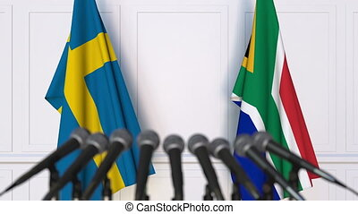 Flags of Sweden and South Africa at international meeting or...