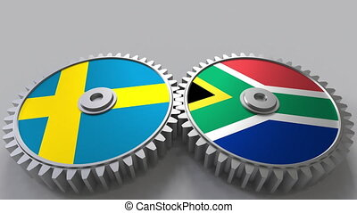 Flags of Sweden and South Africa on meshing gears....