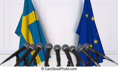 Flags of Sweden and the European Union at international meeting or negotiations press conference