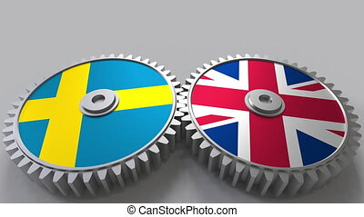 Flags of Sweden and The United Kingdom on meshing gears....