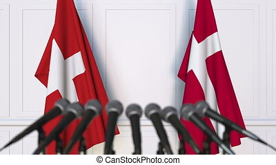 Flags of Switzerland and Denmark at international meeting or...