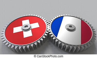 Flags of Switzerland and France on meshing gears. International cooperation conceptual 3D rendering