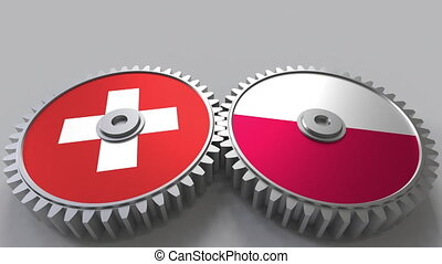 Flags of Switzerland and Poland on meshing gears....