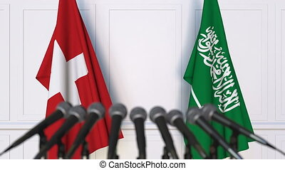 Flags of Switzerland and Saudi Arabia at international...