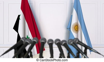 Flags of Syria and Argentina at international meeting or...