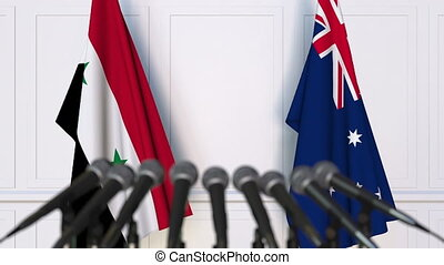 Flags of Syria and Australia at international meeting or...