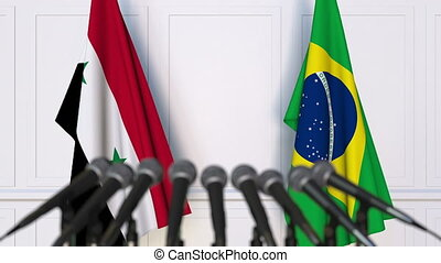 Flags of Syria and Brazil at international meeting or...