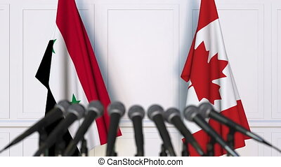 Flags of Syria and Canada at international meeting or...