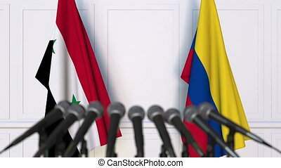 Flags of Syria and Colombia at international meeting or...