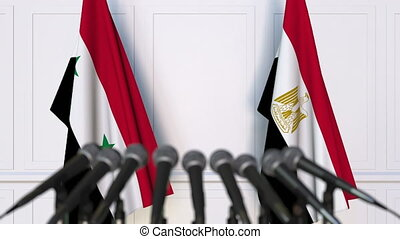 Flags of Syria and Egypt at international meeting or...