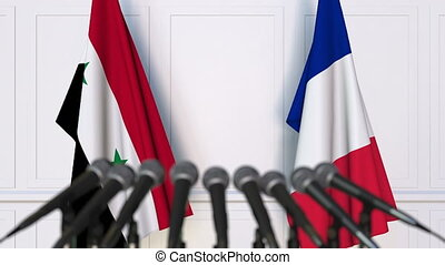 Flags of Syria and France at international meeting or...