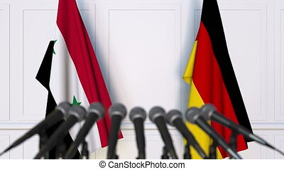 Flags of Syria and Germany at international meeting or...
