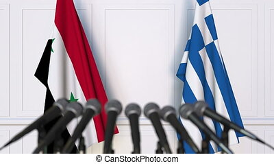 Flags of Syria and Greece at international meeting or...