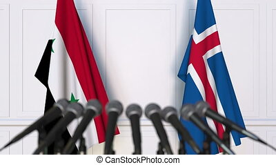 Flags of Syria and Iceland at international meeting or...