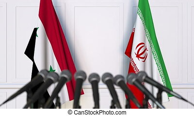 Flags of Syria and Iran at international meeting or...