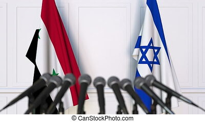 Flags of Syria and Israel at international meeting or...