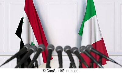 Flags of Syria and Italy at international meeting or...