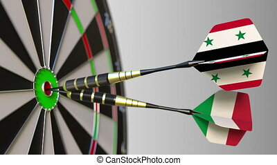 Flags of Syria and Italy on darts hitting bullseye of the...