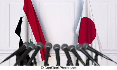 Flags of Syria and Japan at international meeting or...