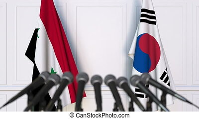 Flags of Syria and Korea at international meeting or...