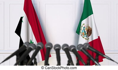 Flags of Syria and Mexico at international meeting or...