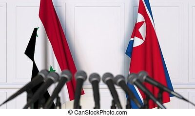 Flags of Syria and North Korea at international meeting or...