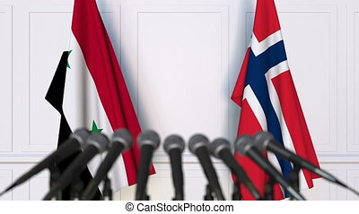 Flags of Syria and Norway at international meeting or...