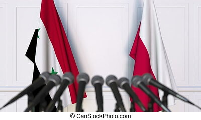Flags of Syria and Poland at international meeting or...