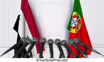 Flags of Syria and Portugal at international meeting or...