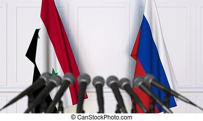 Flags of Syria and Russia at international meeting or...