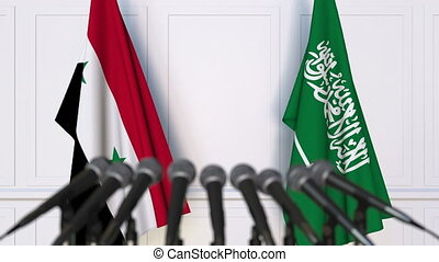 Flags of Syria and Saudi Arabia at international meeting or...