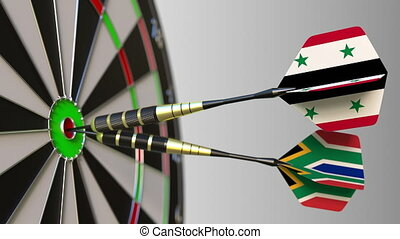 Flags of Syria and South Africa on darts hitting bullseye of...