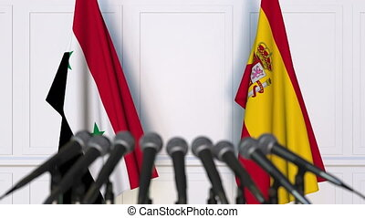 Flags of Syria and Spain at international meeting or...