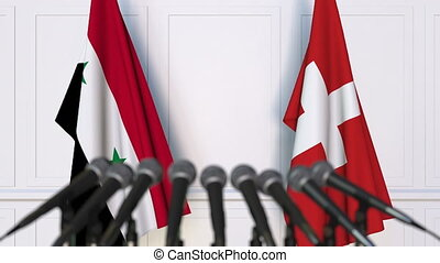 Flags of Syria and Switzerland at international meeting or...