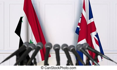 Flags of Syria and The United Kingdom at international...