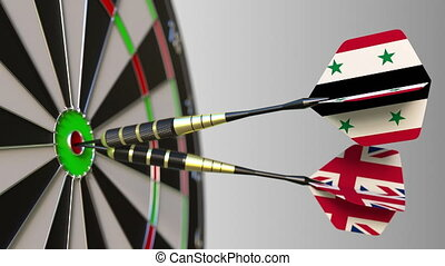 Flags of Syria and the United Kingdom on darts hitting...