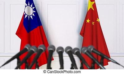 Flags of Taiwan and China at international meeting or...