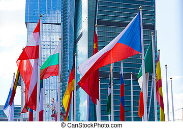 Flags of the different countries against the business center
