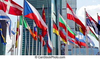 Flags of the different countries of the world against the business center