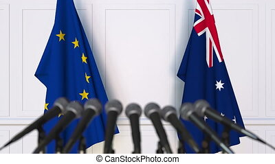 Flags of the European Union and Australia at international meeting or negotiations press conference