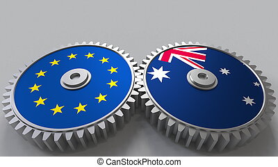 Flags of the European Union and Australia on meshing gears. International cooperation conceptual 3D rendering