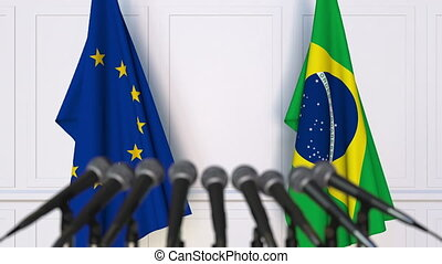 Flags of the European Union and Brazil at international meeting or negotiations press conference
