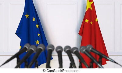 Flags of the European Union and China at international meeting or negotiations press conference