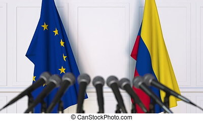 Flags of the European Union and Colombia at international meeting or negotiations press conference